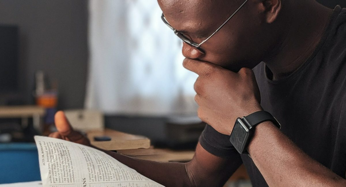 Man reading bible